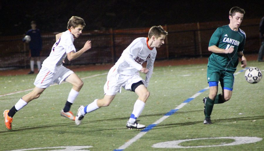 Junior Sean Perkins and Senior Joe Delaney sprint toward the ball in Wednesday's game against Canton.