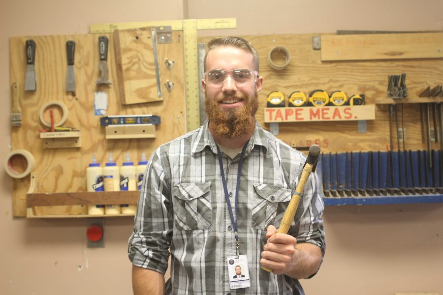 Mr. Reale poses for a photo in the wood shop.