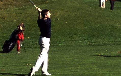 A Walpole golfer sizes up the drive.