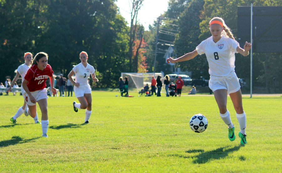 A Rebel player lines up a cross in her game against Milton.