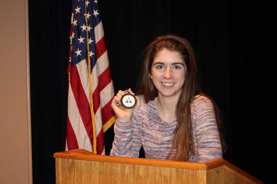 Junior Tess Lancaster showcases her medal from her last competition. Tess will compete at the Grand National Tournament in Fort Lauderdale, FL this May.