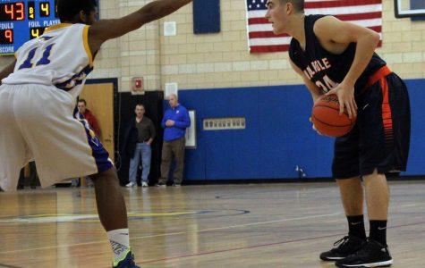 A Walpole athlete looks for an open teammate.