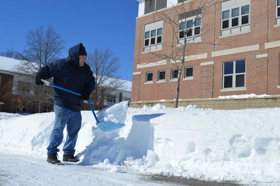 A Walpole High School Custodian shovels the sidewalks during February vacation to ensure that athletes can practice.