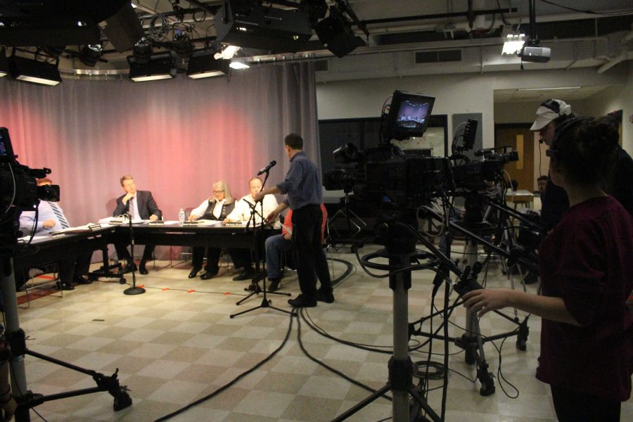 The Walpole School Committee gathers in the TV studio for a meeting broadcasted across town.