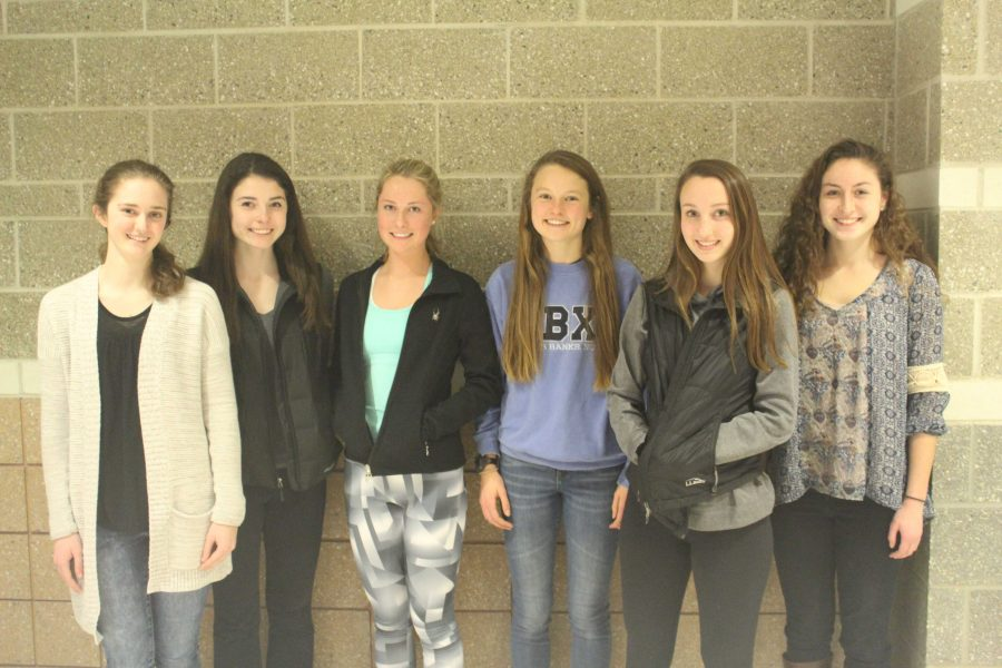 Girls Track Captains pose for a picture.