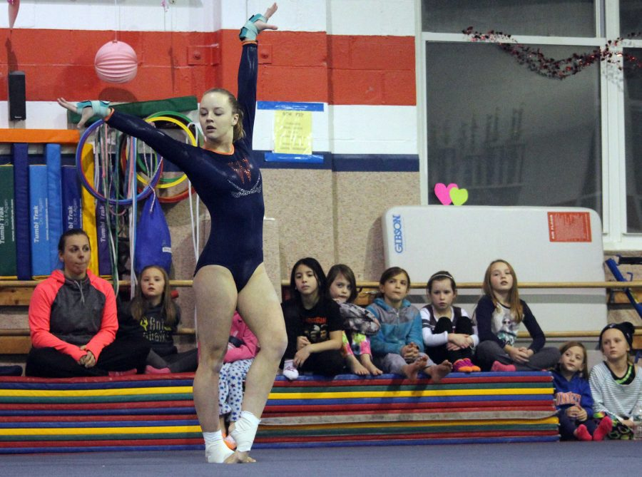A Walpole gymnast competes in the floor routine at a meet.
