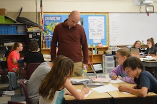 Mr. Kujawski oversees his students doing an activity about the light spectrum on the computers. (Photo/ Cameron Johnson)