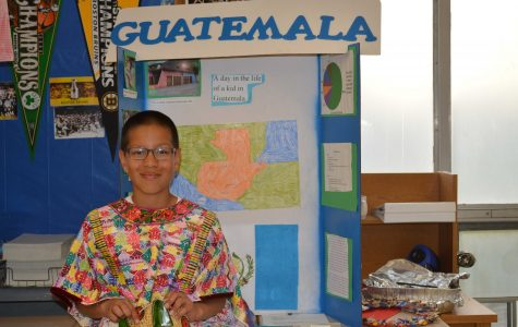 Sixth grade student presents his project on Guatemala on May 21, 2015