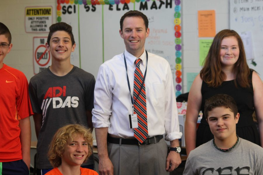 Mr. Hahn poses with students as he is recognized for becoming the new principal at Johnson Middle School Photo/ James Randall