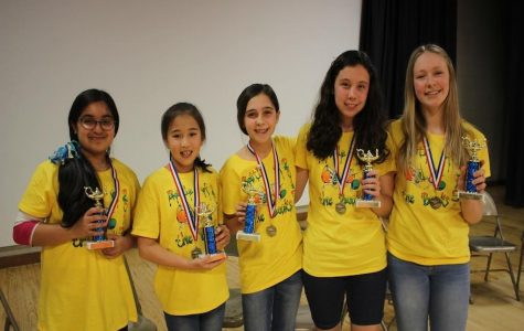 The winning Johnson Middle School battle of the books team poses with their medals. / picture by Brenna Manning