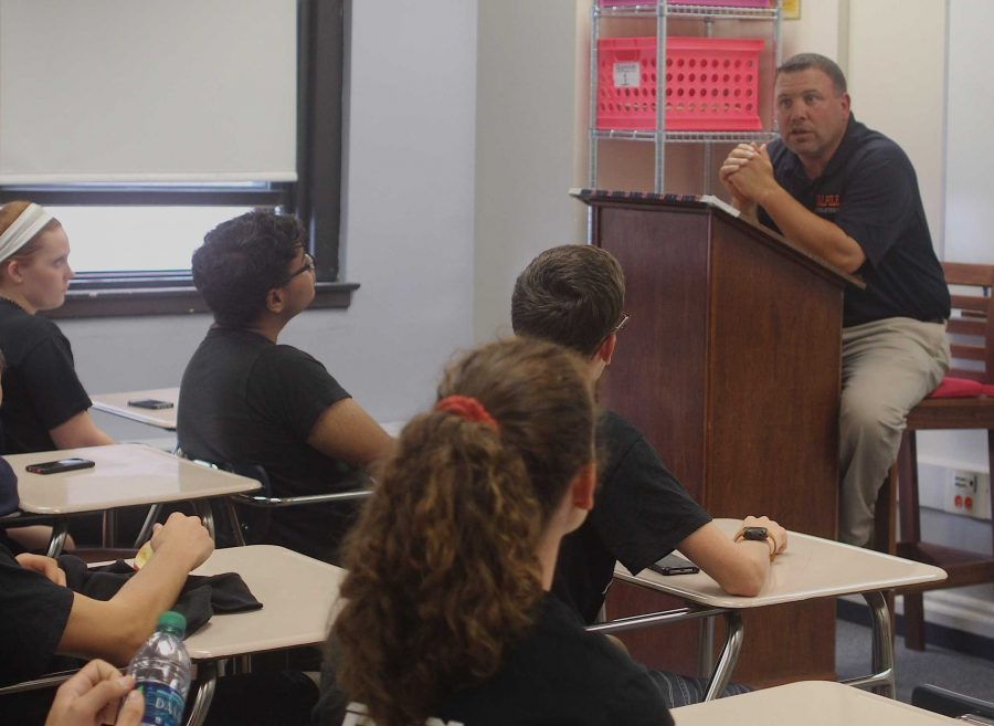 Mr. Dowd speaks to team captains about school and athletic issues. He plans to meet with captains monthly.