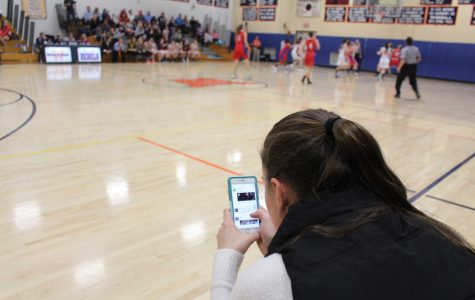 Students are notorious for using their cell phones during social events, from basketball games to hanging out with friends.  The use of this technology may distract from truly enjoying life experiences.