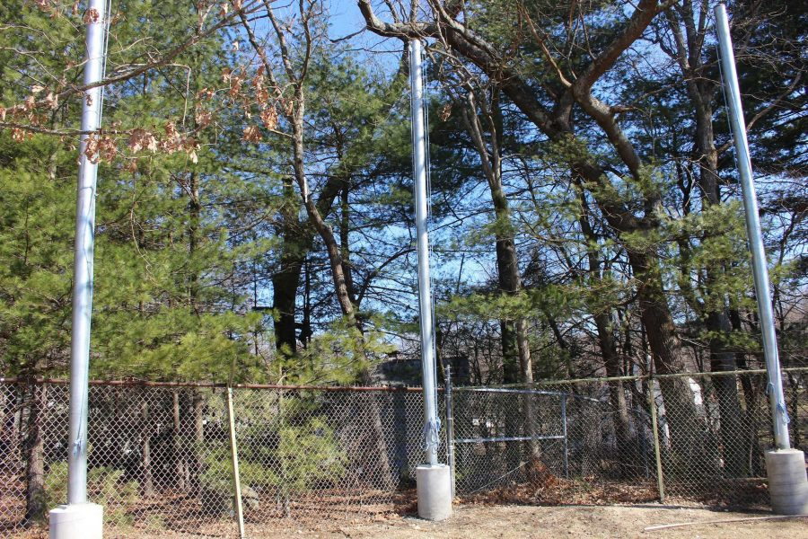 The confederate flag no longer flies on the neighbor's property. Currently, there are no plans for how to use the Walpole School Committee poles, previously used to hang banners to block the flag. (Photo/ Max Simons)