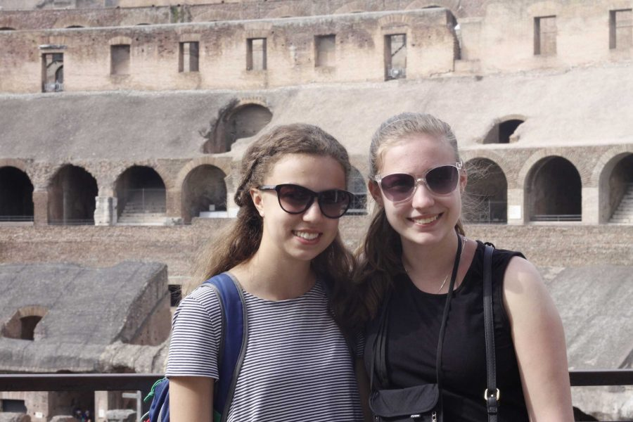 Junior Devin McKinney and Gayle McAdams smile for a photo at the Colosseum in Rome.