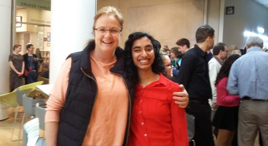 English Department Head Lauren Culliton poses for a photo with senior Archana Apte at the Scholastic Art and Writing competition.