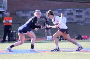 Junior Melanie Weber faces off against Wellesley during their game on April 14 (Photo/ Hiromi Kondo).