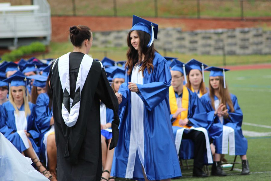 Angela accepts her diploma at the graduation ceremony (Photo/ Mandy Scully)