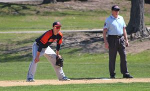 Walpole Rebels first baseman stands ready during Monday's game.