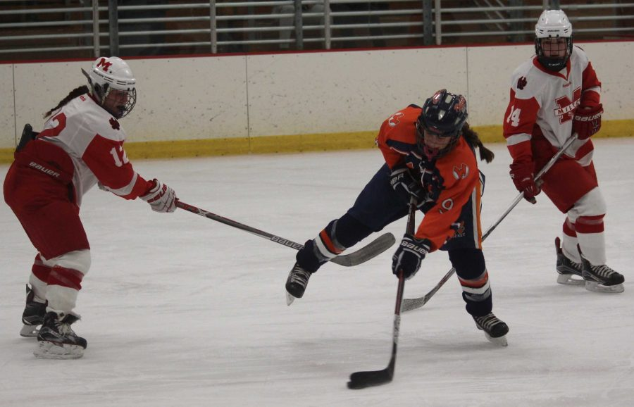 Freshman  catie martin    takes a  shot off  of one  skate  in  a  Regular  season game  against milton.