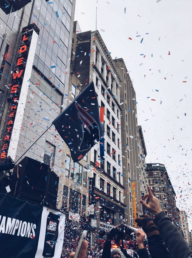 Pictured above: Students celebrate among other Patriots fans as the team travelled closely past on duck boats. The parade was scheduled to start at 11 a.m., but did not begin until 12 p.m. Nonetheless, fans waited out the delay to scream and dance in the confetti filled streets.