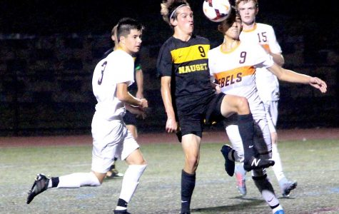 Senior Luccas Ferreira goes up for the header against Nauset's Ethan Craven.