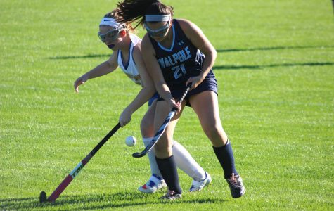 Senior Alex Rodia fights for the ball against Allie Martin in an earlier from this year.