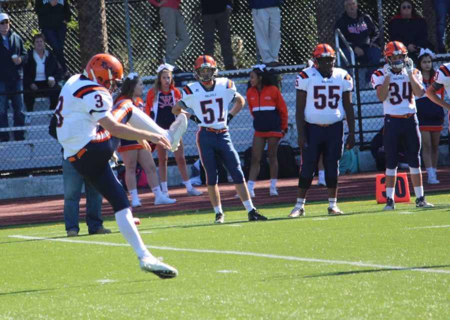 Senior Brett Lavanchy punts the ball down to Wellesley's end.