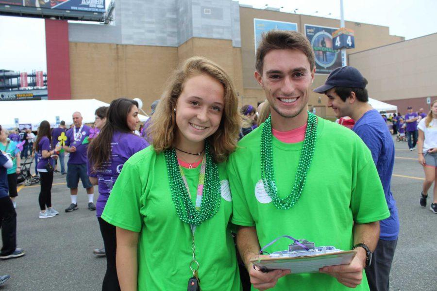 Emily Ball and Billy Porter organize student volunteers. (Photo/ Ryan Conlon)