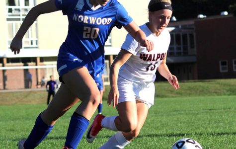 Norwood's Tara O'Brien chases down Walpole's Hallie McLaughlin.