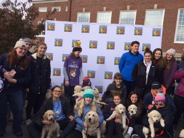 Walpole+Best+Buddies+pose+for+a+group+photo+with+the+service+dogs.
