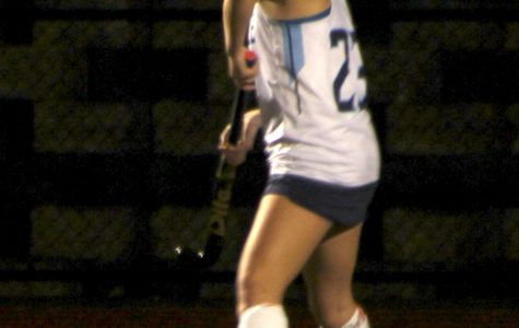 Walpole junior Caileen Quinn goes to drive the ball up the field.