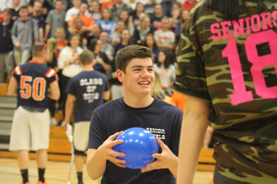 Conor McMahon prepares for the balloon pop game.