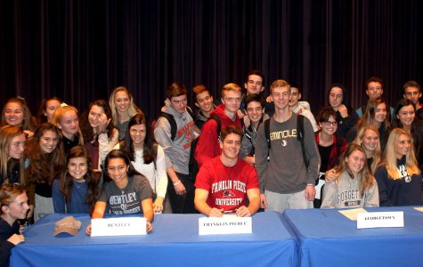 Walpole High School students congratulate their classmates for their college commitments.
