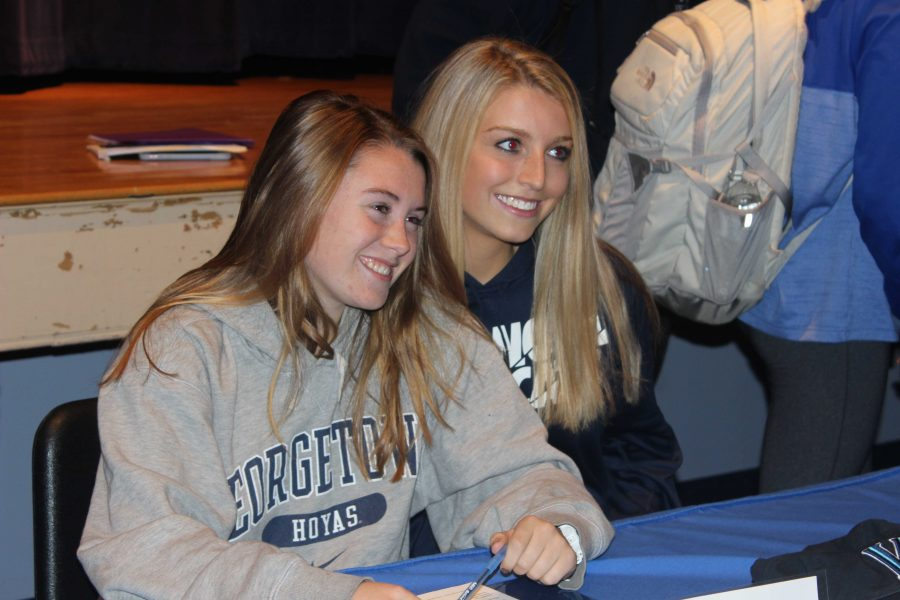 Seniors Celia Walsh and Emily Curtis pose for a picture after signing their Letters of Intent to Georgetown University and Villanova University.