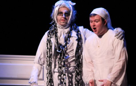 Ebenezer Scrooge (Riley Mulroy) is suprised after the arrival of Bob Marley's ghost (Joey Haskins)