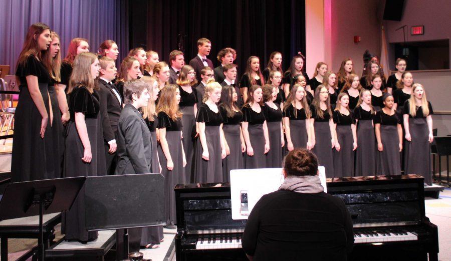 The choir sings Christmas songs.