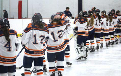 Girls hockey faces off against Needham.