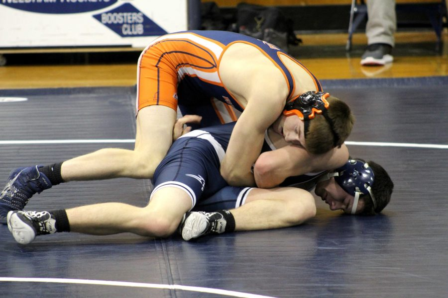 Senior captain Paul Kauranen battles his opponent from the top position in Walpole's dual meet against Needham.