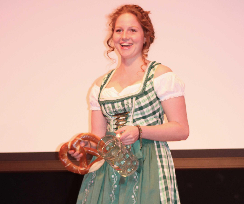 Senior Dana DeMartino celebrates her German heritage at the date auction.