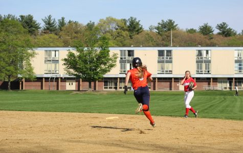 Varsity Softball Clinches Playoff Spot With a 14-8 Win Over Natick Red Hawks