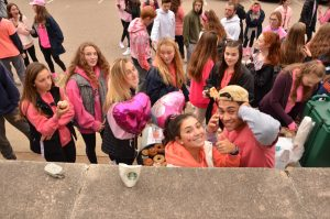 Students enjoy coffee, pastries, and more after the walk.