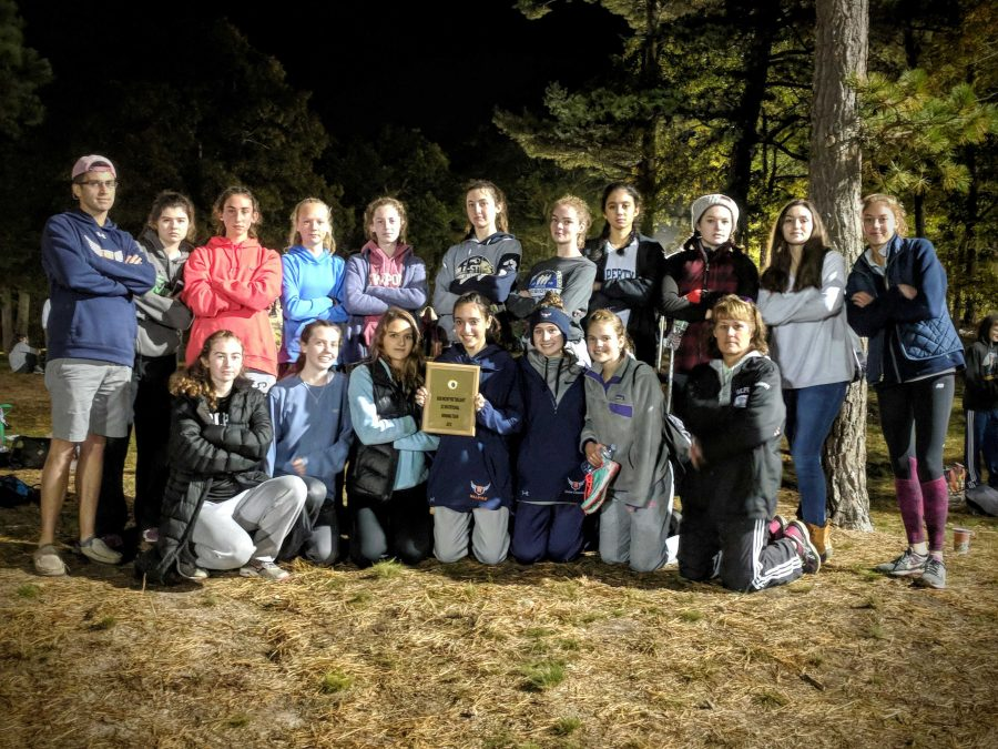 Walpole Girls XC poses with the first place plaque after the meet (Photo/ David Forester).