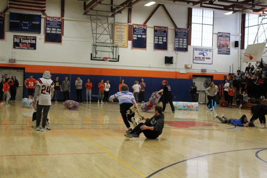 One of the final activities, relay races, involved dragging teammates across the gymnasium floor.