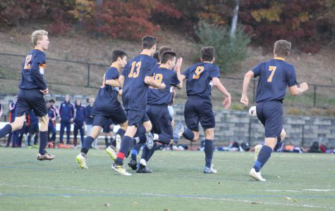Walpole boys celebrate after scoring (Photo/ Sarah St. George).