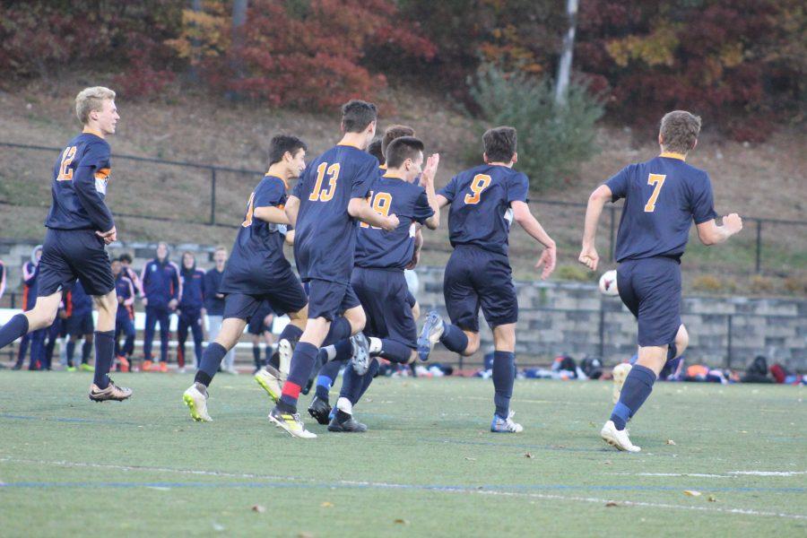 Walpole boys celebrate after scoring (Photo/ Sarah St. George).
