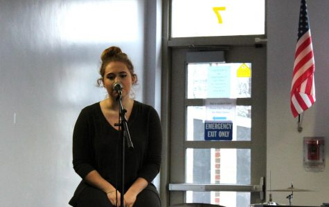 Senior Meghan Angelo performs at the Coffee House.