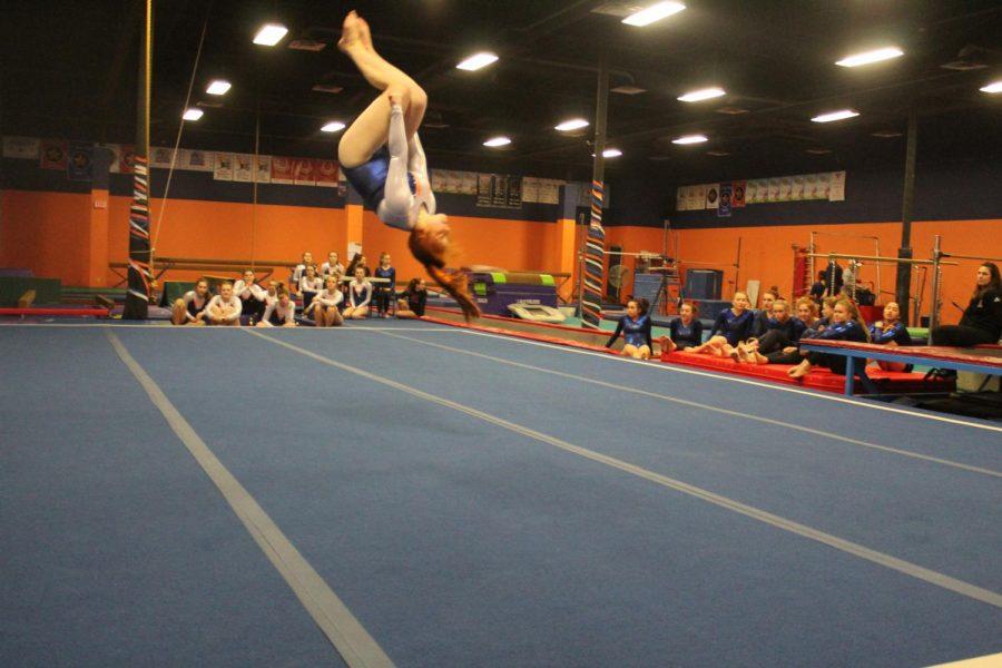 Freshman+Mckenzie+Bourque+performs+a+back+tuck+in+her+floor+routine.
