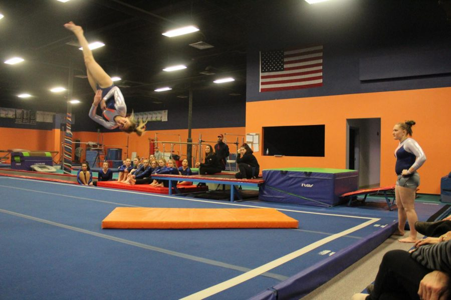 Gabby O'Hara performs her full and a half twist in her floor routine.