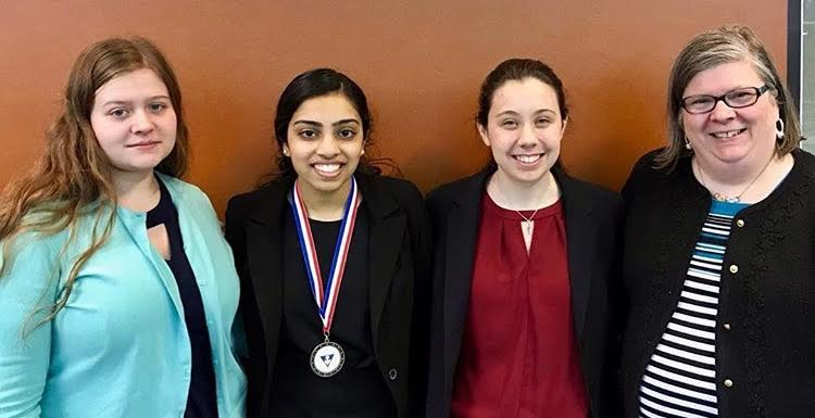 Annika Ruda, Lindsay Navick and Tammie Ruda pose with NCFL qualifier Reshma Abraham at the NCFL Qualifier tournament.