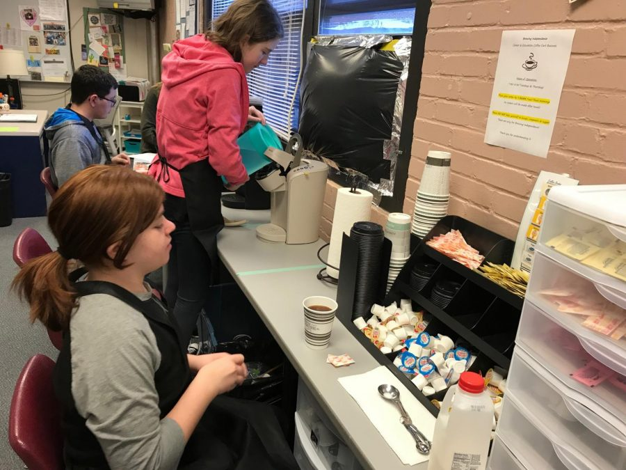 Students prepare their coffees for the day.